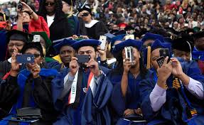 obama us in better place than when he graduated college whp graduates photograph president barack obama as he gives his commencement address to the 2016 graduating class