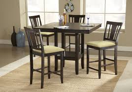 tall dining chairs counter: counter height dinette set with wooden table and four chairs warm rug of dining room