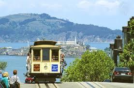San Francisco cable car    Kids Encyclopedia   Children     s Homework     Photograph A cable car runs on one of San Francisco     s steep hills  Alcatraz Island