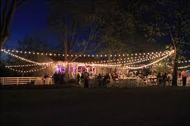 cafe lights strung for a wedding barn barn wedding lights