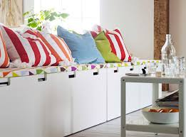 a row of childrens ikea storage benches with pads and cushions on top baby playroom furniture