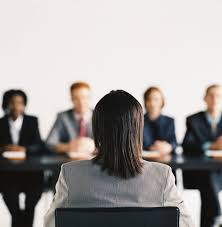 asking the tough questions during an interview the upwards leader view of a team of business executives sitting at a table