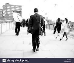 commuters walking over london bridge people walking to work man in stock photo commuters walking over london bridge people walking to work man in suit walking w walking rushing to work man walking