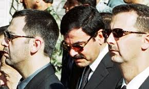 Bashar and Maher al-Assad. Bashar al-Assad (right) with his brother Maher (left) and brother-in-law Major General Assef Shawkat (centre) in June 2000. - Bashar-and-Maher-al-Assad-006