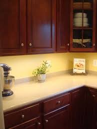 photo showing new xenon thin under cabinet task lights added to a kitchen cabinet xenon lighting