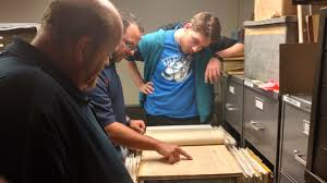adec partners city of elkhart to provide job shadowing matt heinman center shows dylan eberly right and mike delfine an old atlas