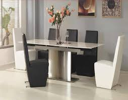 black and white dining table set:  charming modern black and white color dining chairs completed with white marble dining table using chrome