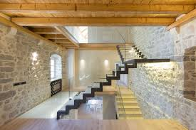 modern renovation of a 19th century old stone house in montenegro rustic walls and glass staircase aviator villa urban office architecture