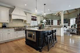 kitchen with white cabinets and black cabinet with beige granite custom island bathroom pendant lighting ideas beige granite