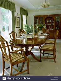 Chippendale Dining Room Table Oval Mahogany Table And Upholstered Chippendale Style Chairs In