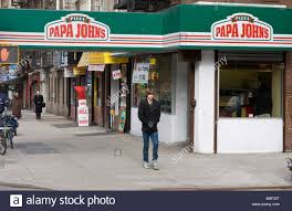 pizza restaurant ny stock photos pizza restaurant ny stock the outside of a papa john s restaurant is seen in new york ny stock