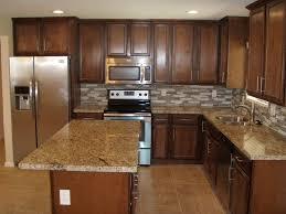 limestone tiles kitchen: contemporary kitchen with kitchen island amber yellow granite countertop limestone tile floors ceramic