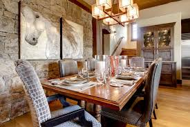 rustic hutch dining room: horse barn pictures dining room rustic with chandelier dining buffet dining