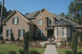 Photo Tour   Frank Betz Associates  Inc  The Greenlaw House Plan    The bayed living area creates an interesting turret detail that highlights the front entry  Brick lends a traditional feel to this two story plan