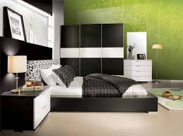 marvellous green accent wall color with modern bedroom furniture involving white king bed on black wooden black bed with white furniture