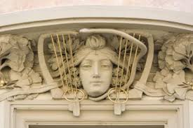 how can you tell if the architecture is art nouveau art nouveau detailing  carved stone w     s face surrounded by stone flower petals and lyre