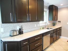 black and stainless kitchen black color scheme kitchen cabinet with white granite counter top and stainless steel kitchen sink and