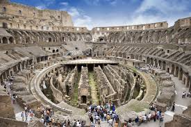 Modern visitors wander around the ruins of the Colosseum in Rome  BBC