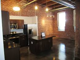 downtown lexington loft living: high ceilings exposed brick walls expansive views of your favorite cityvisit leasingkccom to find downtown loft apartments in kansas city