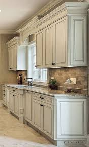 painted kitchen cabinets vintage cream: antique white cabinets with clipped corners on the bump out sink granite countertop arched valance more at painting kitchen cabinets fosterginger