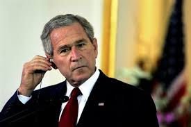 President George W. Bush headphones Let's Not Get Carried Away