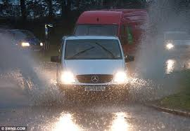 Image result for free picture of car in rain with headlights on