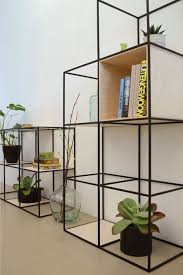 beautiful shelf built up symmetrically and made of fine steel and plywood steelshelf beautiful combination wood metal furniture