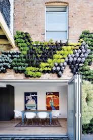 gallery outdoor living wall featuring: a living wall with various types of plants