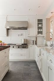 kitchen floor tiles small space: beautiful kitchen design with white shaker kitchen cabinets with caesarstone concrete countertops glossy white beveled subway tiles backsplash pot filler