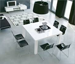 black and white dining table set:  black table centerpieces  chairs white leather kitchen dining room and living bined  baytownkitchen