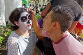 photo essay  the day of the dead in oaxaca   road affairgirl painting her face for the day of the dead celebration in oaxaca