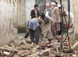 powerful earthquake shakes south asia newshour residents gather in mingora swat to clear a path through rubble caused