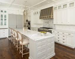 wood drawer kitchen baking island white and gray kitchen features a beadboard ceiling dotted with pot li