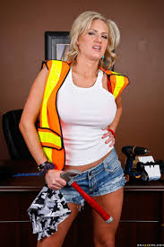 Busty construction worker Zoe Holiday gets her ass pounded.