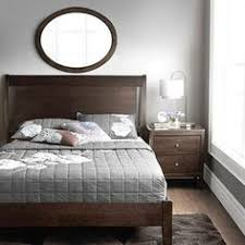 i love how simple this is and that they were not afraid to mix grey bedroom colors brown furniture