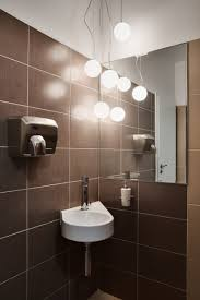 awesome romantic bathroom lighting using many white rounded lamps hanged on the ceiling awesome bathroom lighting bathroom pendant lighting