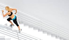 woman running stadium steps