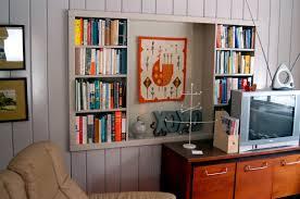 storage solutions living room: varnished wood book storage furniture living room storage solutions