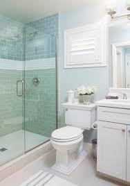 coastal bathroom designs: coastal bathroom with aqua blue subway tile agk design studio