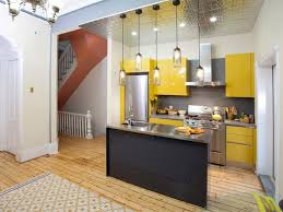 small space kitchen ideas:  hkitc yellow loft kitchen wide sxjpgrendhgtvcom