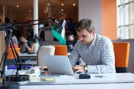 startup business software developer working on computer at modern office business computer
