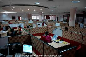 software company office. indian people at work in infosys bangalore is the largest software company office e