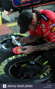 brooklyn michigan u s one of the mcdonald s 19 2011 brooklyn michigan u s one of the 1 mcdonald s crew member applies an adhesive to a lugnut so it will stay in place for a tire change