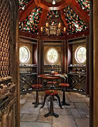antique chairs and table for one of a kind tasting room design michael lyons arched table top wine cellar furniture