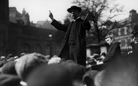 from michael lewis to montaigne the best writers first live an the rev c j russell speaking to a crowd during the 1906 election