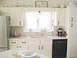 harmonious hanging white wooden kitchen cabinet and delightful white kitchen counter also enchanting white light over kitchen sink decoration light over above sink lighting