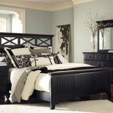 love the wall color with the black furniture black furniture wall color