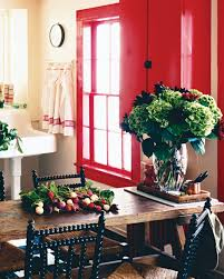 dining room khaki tone: red window frames this kitchen