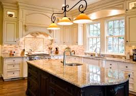 pendant lights with a traditional touch above a glazed marble kitchen island center island lighting