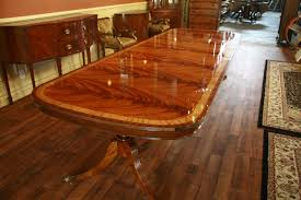 long wood dining table: large dining room table shown fully opened with  leaves seats  to  people